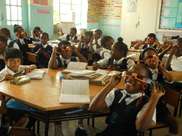 Children with eclipse glasses