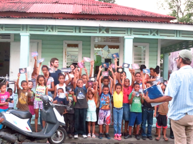 Children posing with postcards donated by ESO