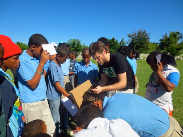 Sebastian while conducting the solar projection activity with the students